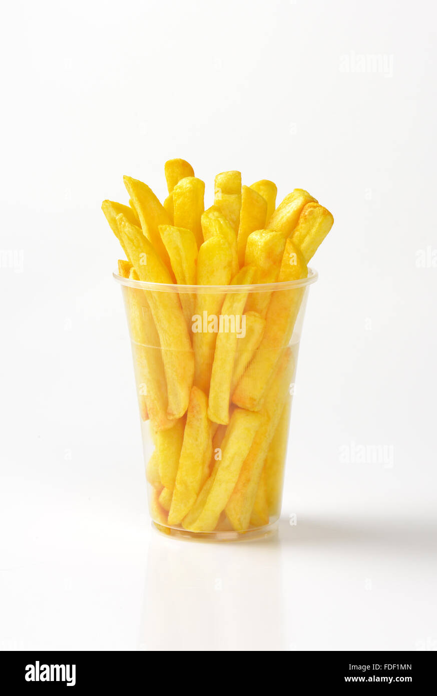plastic cup of french fries on white background - Stock Image