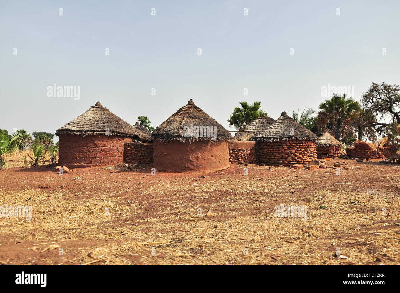 Round brick huts near Grottes de Nok in Togo in rural Western Africa - Stock Image