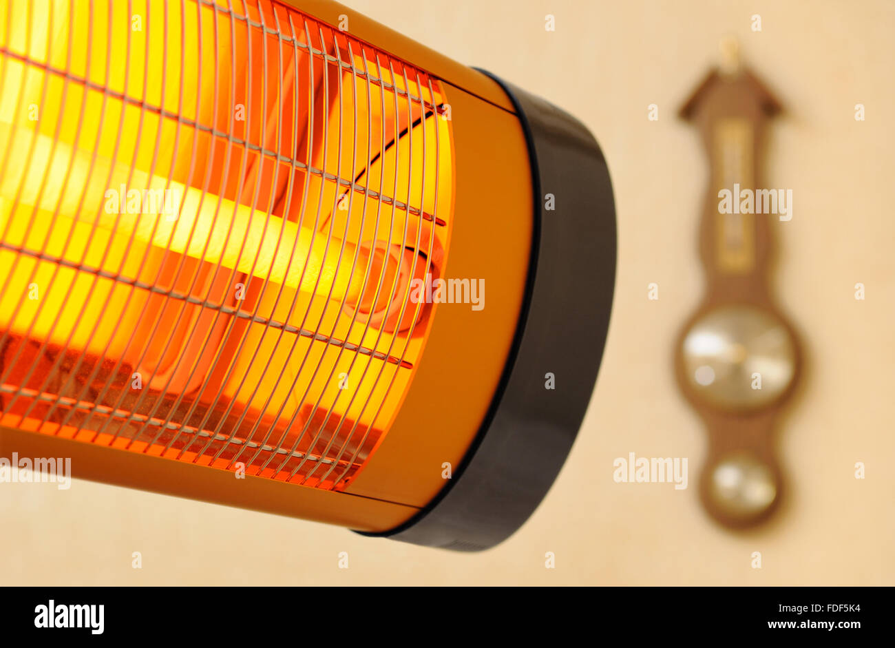 House Infra-red heater and barometer - Stock Image