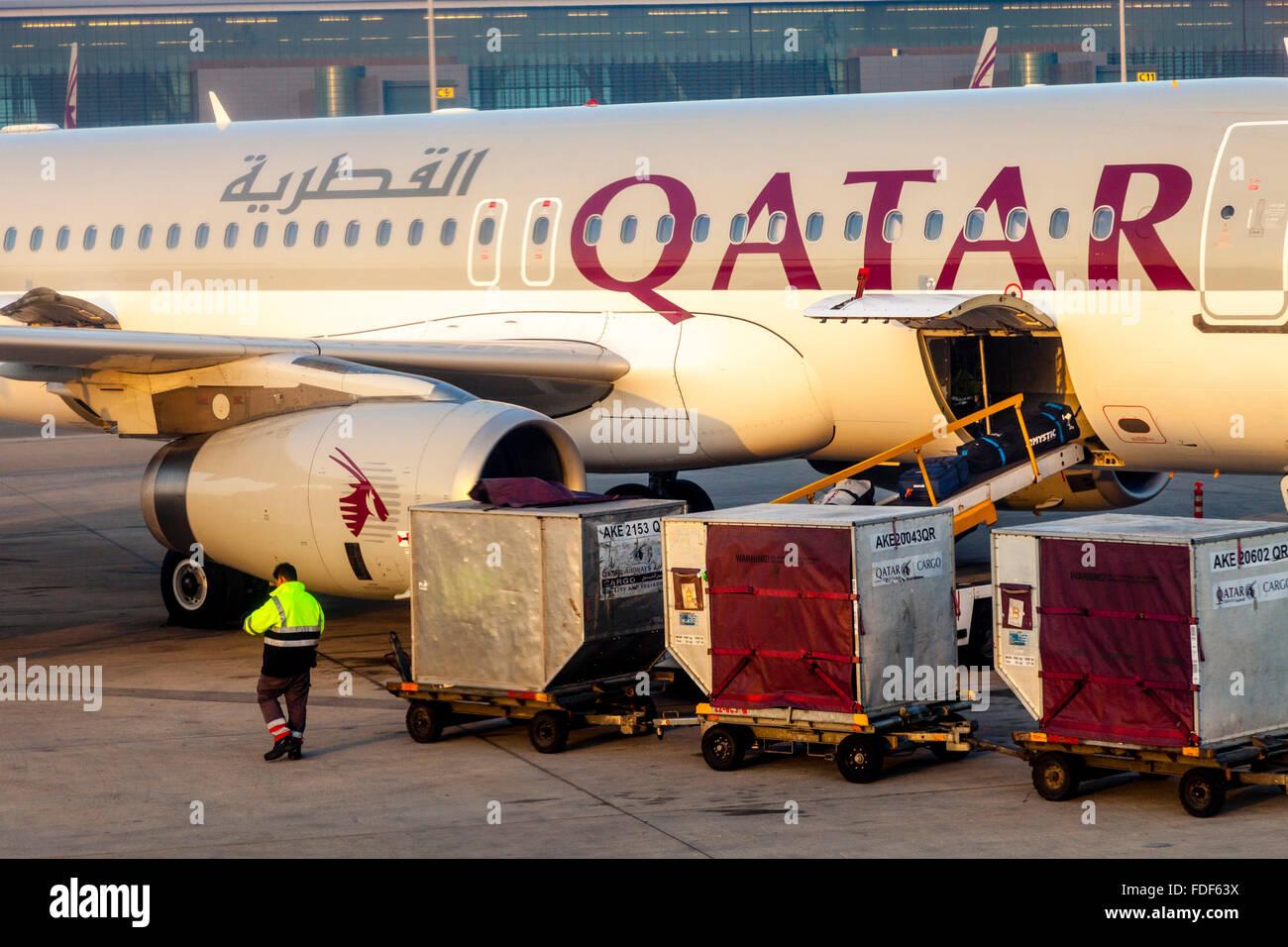 Baggage Being Loaded On To A Qatar Airways Flight, Hamad International Airport, Doha, Qatar - Stock Image