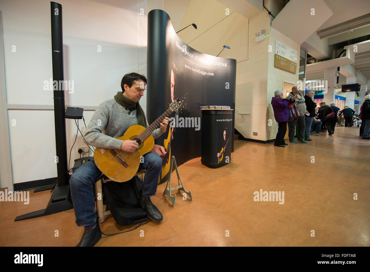 Guitarist playing at the Winter Crafting Fair at Sandown Park racecourse, Surrey - Stock Image