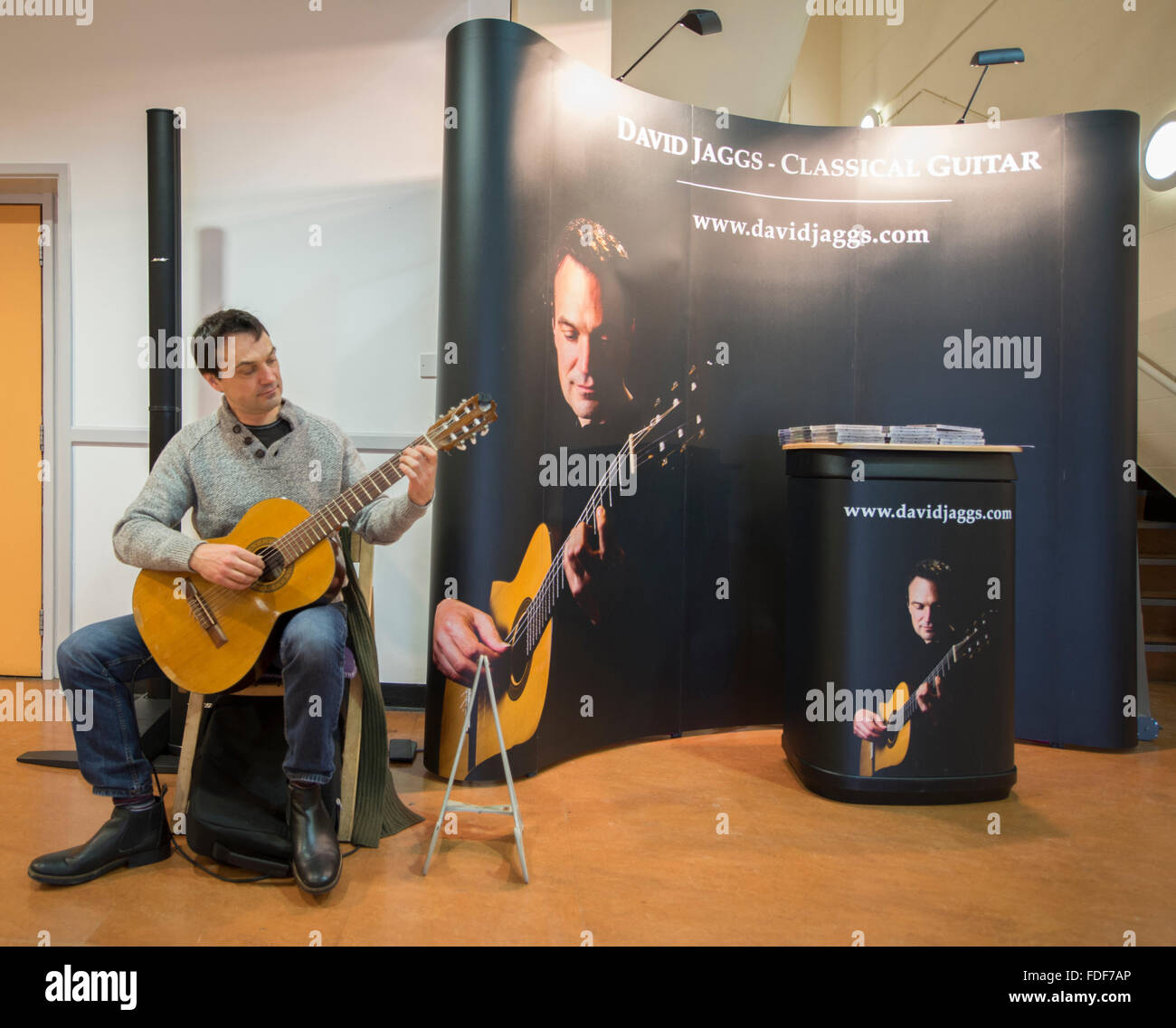 Guitarist playing at the Winter Crafting Fair at Sandown Park racecourse, Surrey Stock Photo