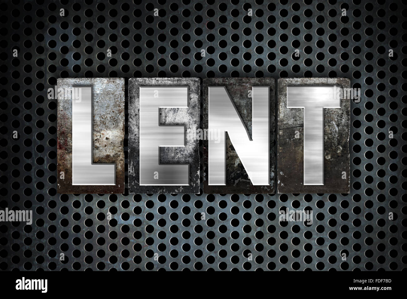 """The word """"Lent"""" written in vintage metal letterpress type on a black industrial grid background. Stock Photo"""
