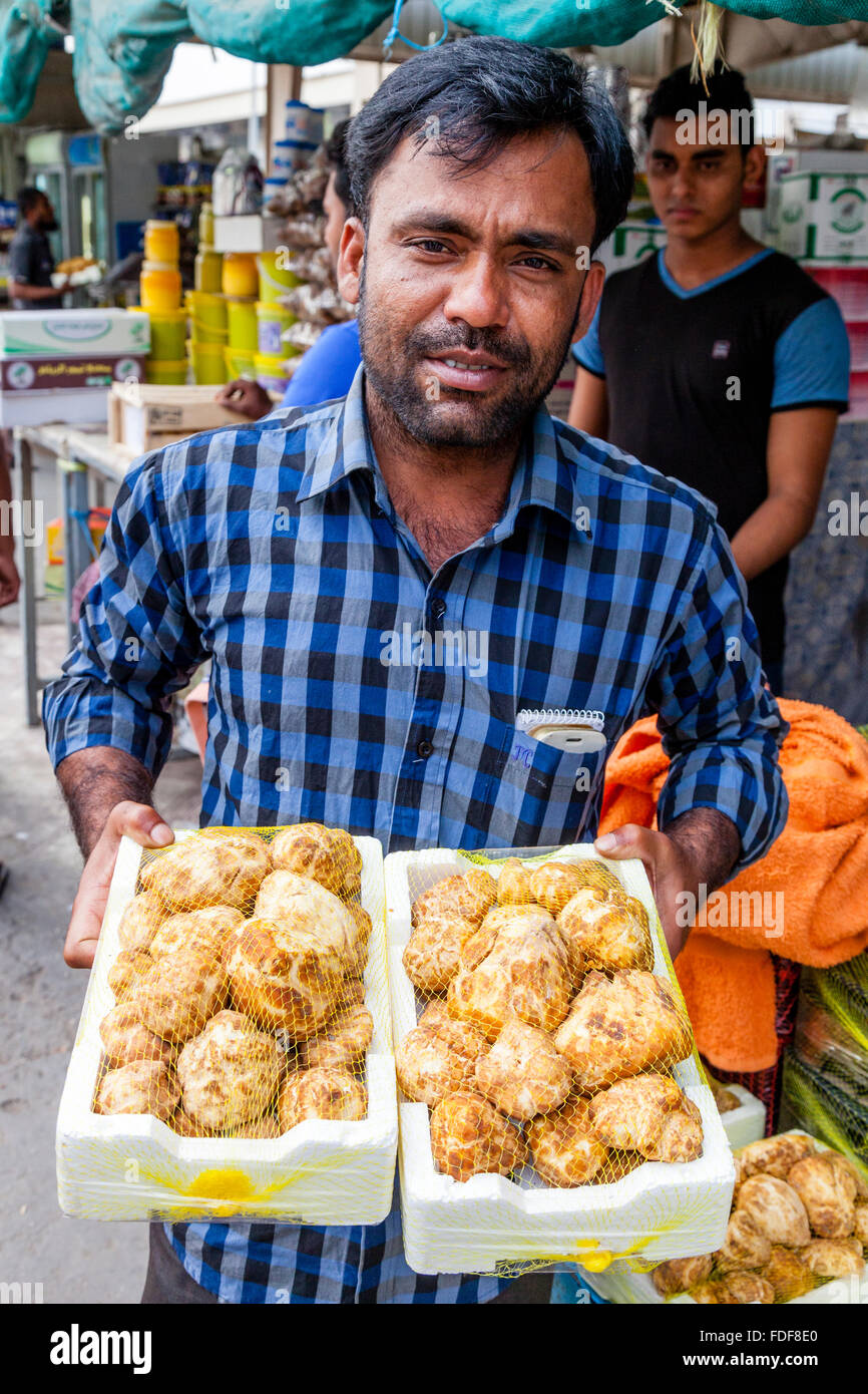 A Bangladeshi Migrant Worker Selling Imported Truffles, The Municipal Market, Doha, Qatar - Stock Image