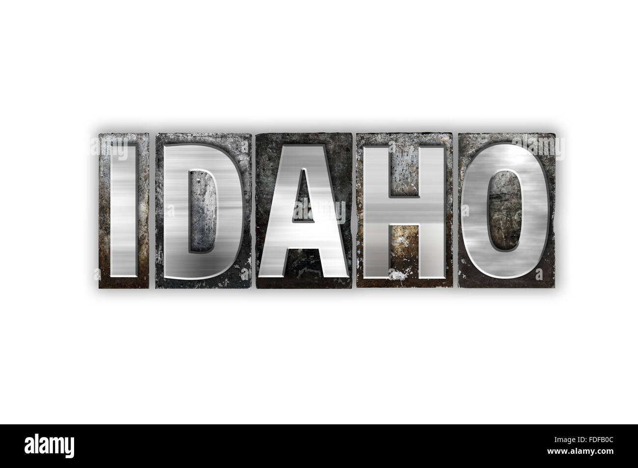 The word 'Idaho' written in vintage metal letterpress type isolated on a white background. - Stock Image