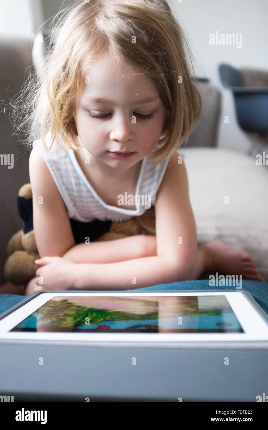 Girl on Ipad - Stock Image