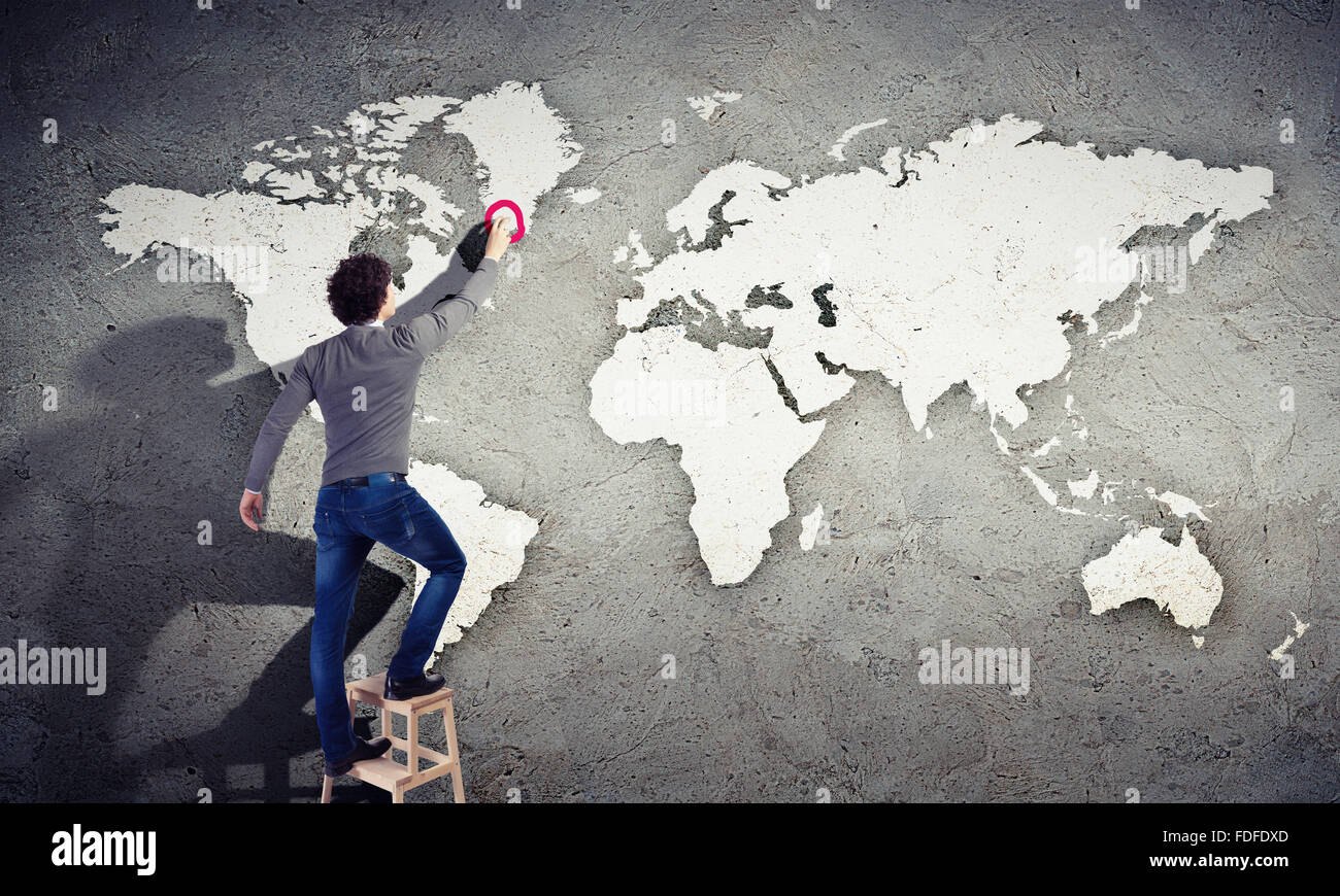 Young man drawing a world map on the wall stock photo 94382581 alamy young man drawing a world map on the wall gumiabroncs Gallery