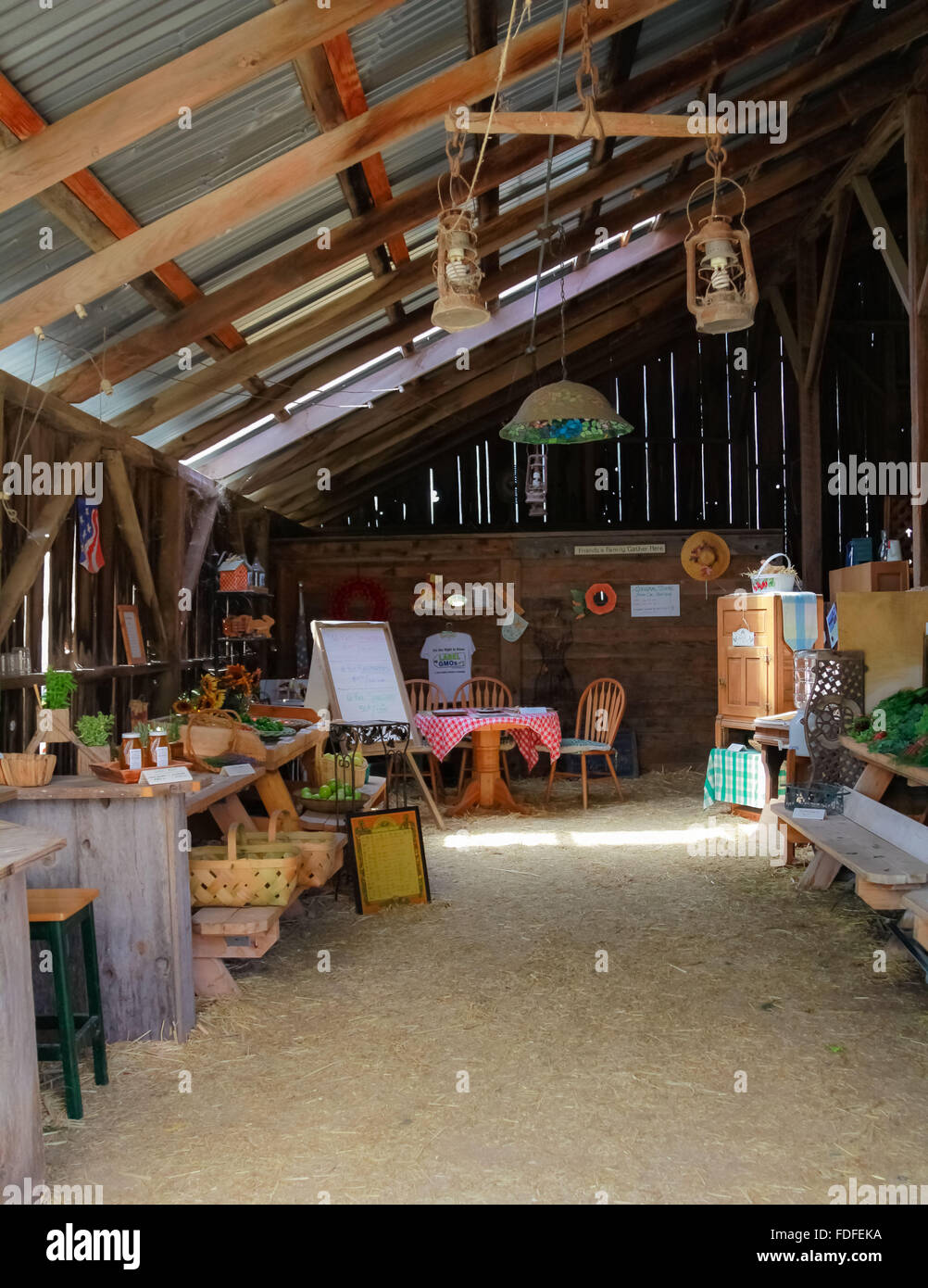 Farmers Market Inside A Small Furnished Barn With Various Organic Produce For Sale And Sunshine Filtering