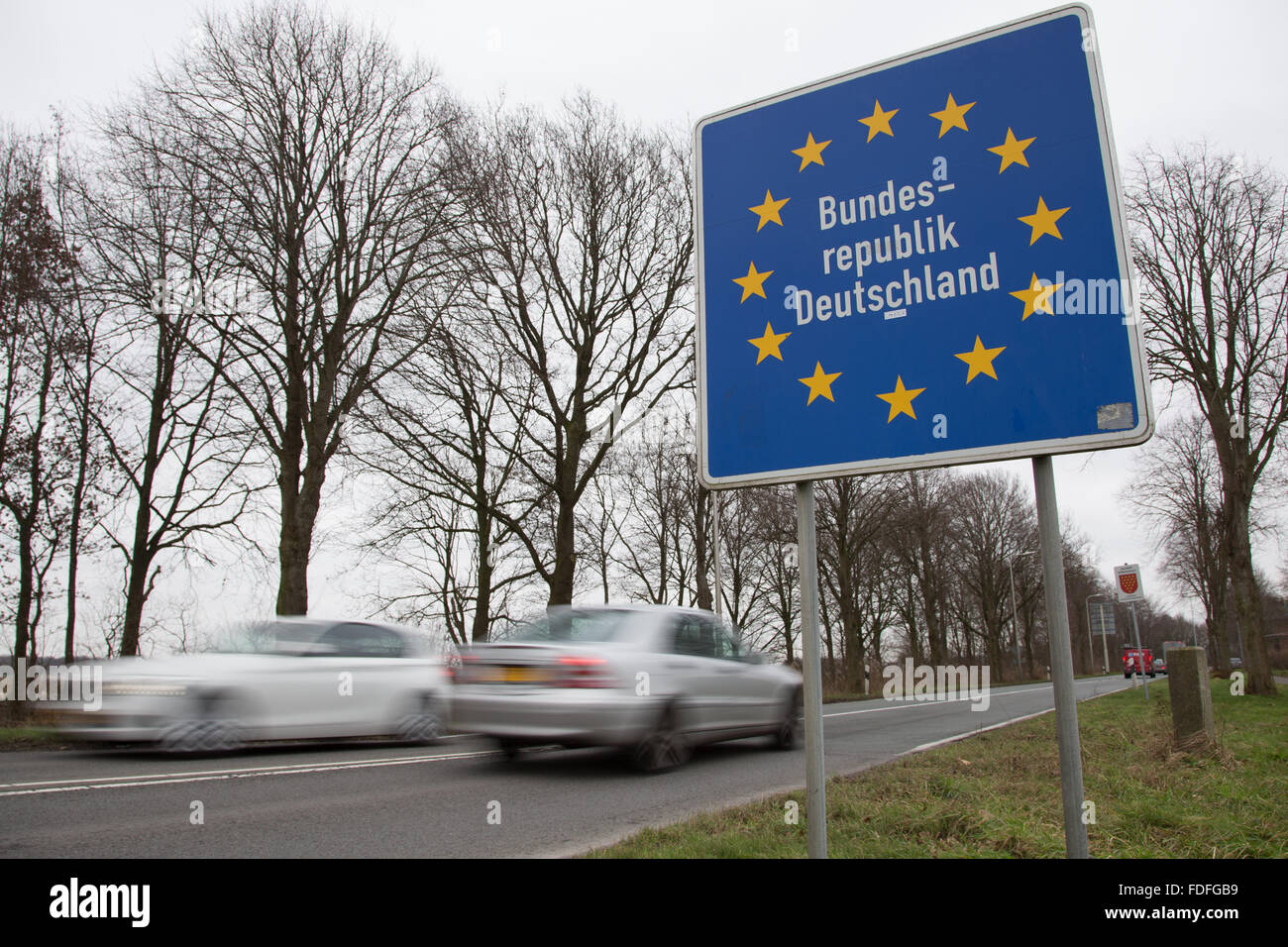 A border sign that reads 'Bundesrepublik Deutschland' (Federal Republic of Germany) is pictured at the border - Stock Image