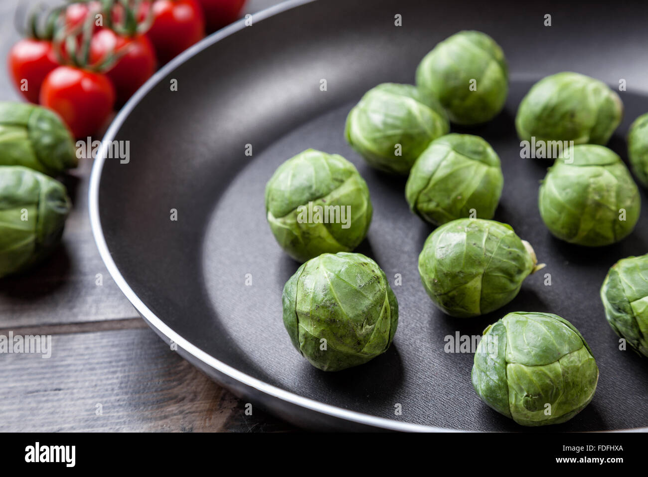 Fresh and healthy organic brussel sprouts in a frying pan - Stock Image