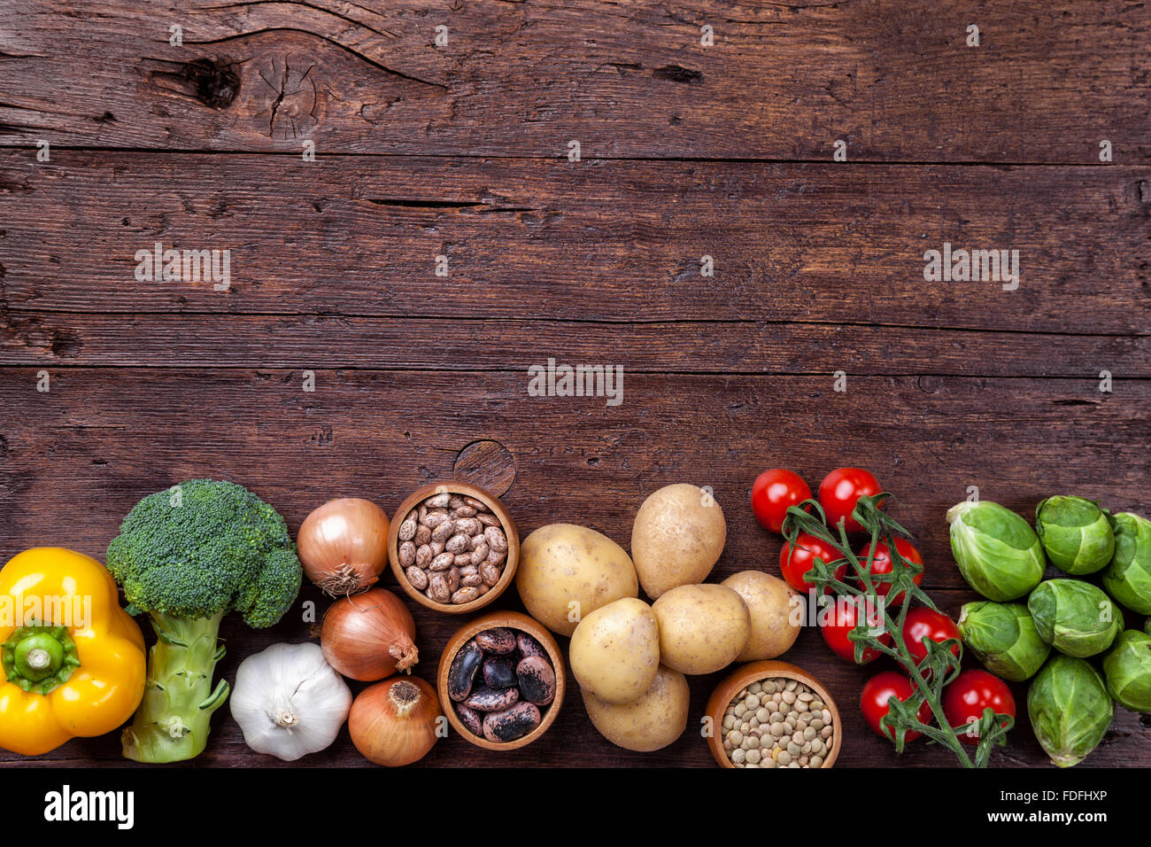 Fresh and healthy organic vegetables and food ingredients on wooden background - Stock Image
