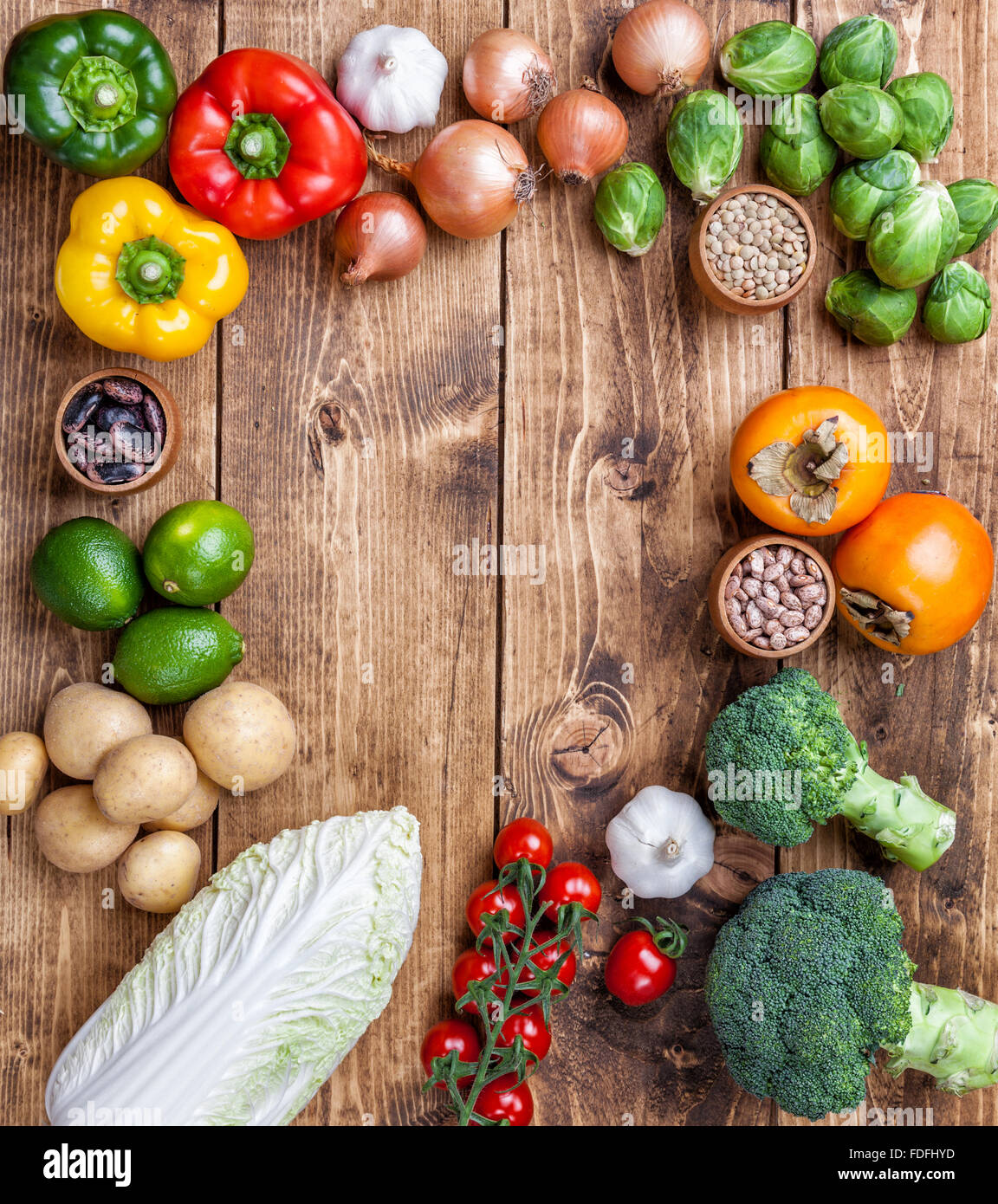 Fresh and healthy organic vegetables and food ingredients on wooden background Stock Photo
