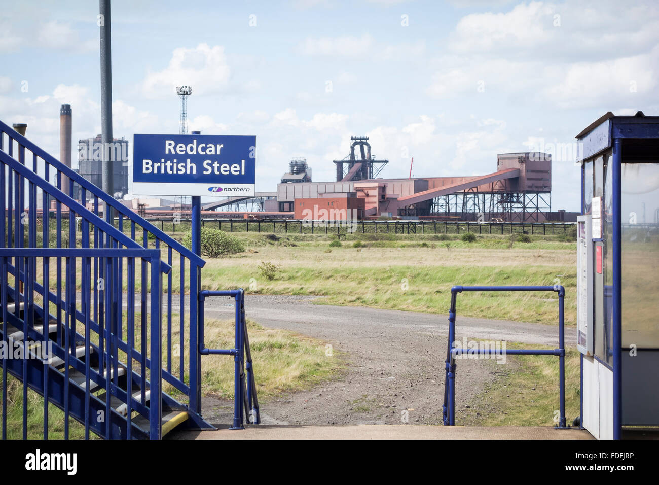Train station at Redcar British Steel with blast furnace in background. Redcar, England, UK. The least used station - Stock Image