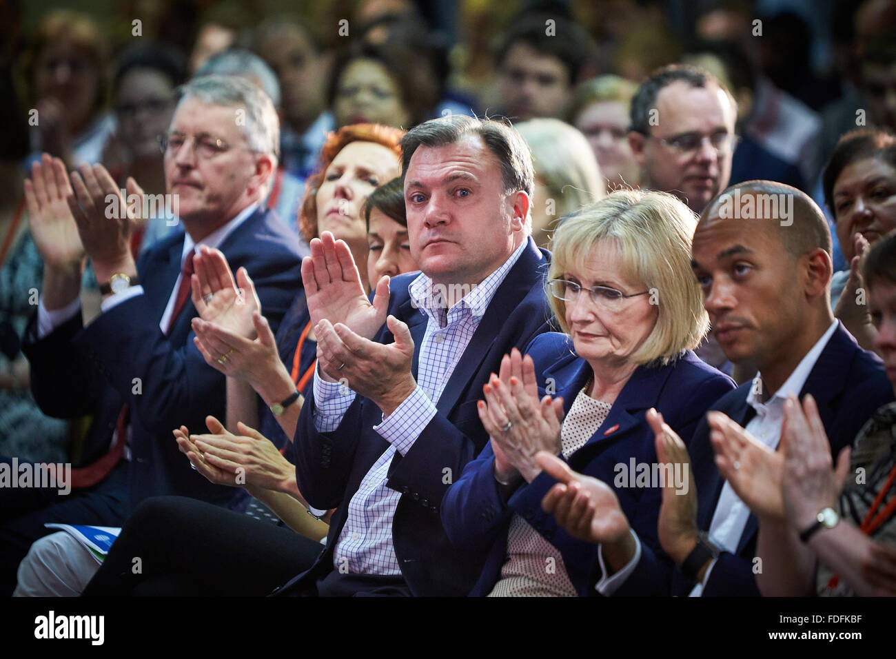 Labour party members including Ed Balls (C) listening to leader Ed Miliband (not seen) at the 2014 National Policy - Stock Image