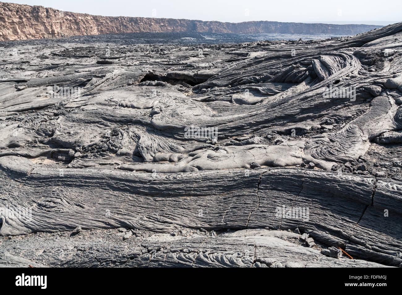 Swirls of grey basalt lava fill the caldera at the summit of Erta Ale volcano in Ethiopia - Stock Image