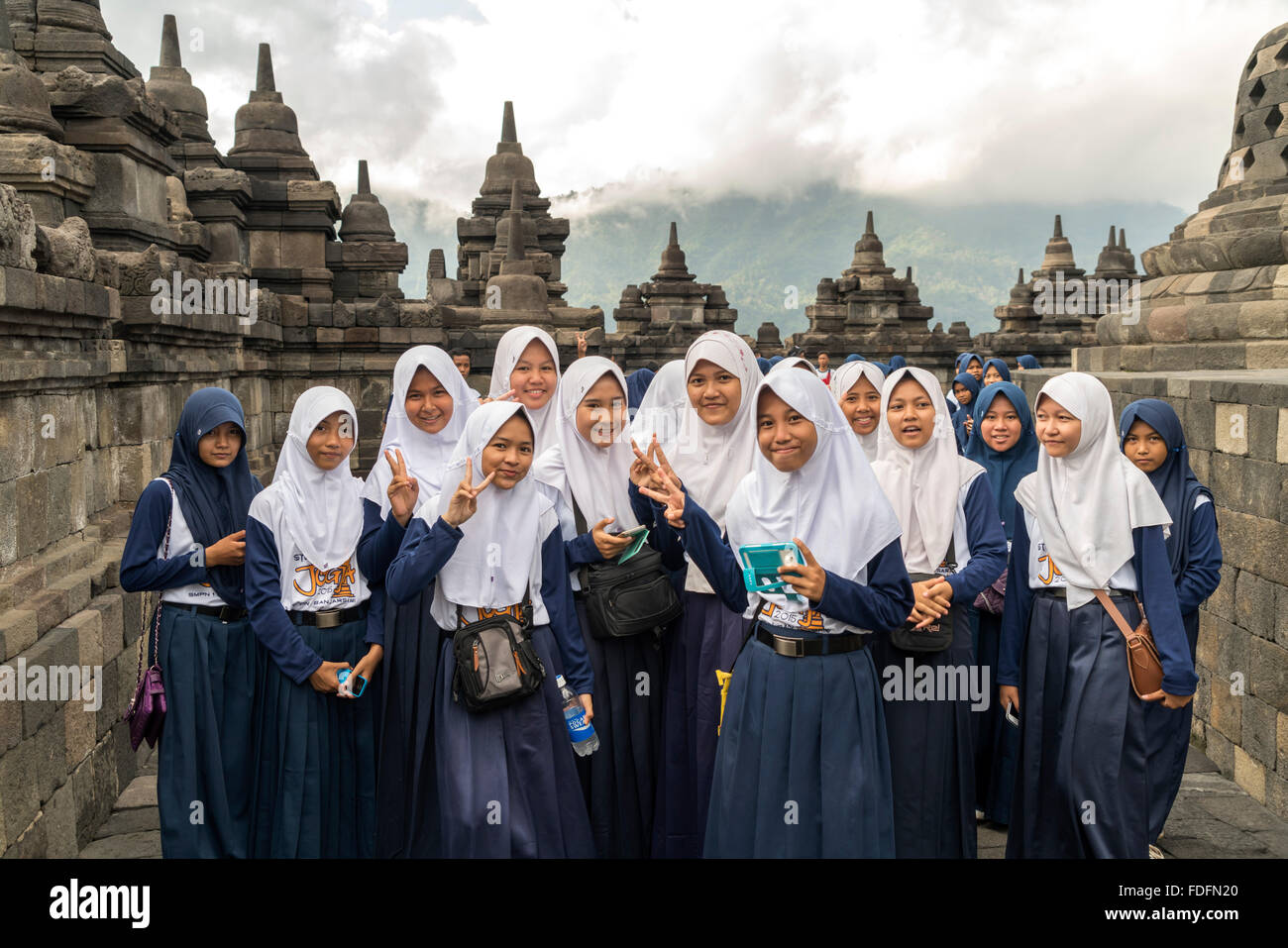 Muslim schoolgirl in uniform with headscarf, Buddhist temple complex Borobudur, Yogyakarta, Java, Indonesia, Asia - Stock Image
