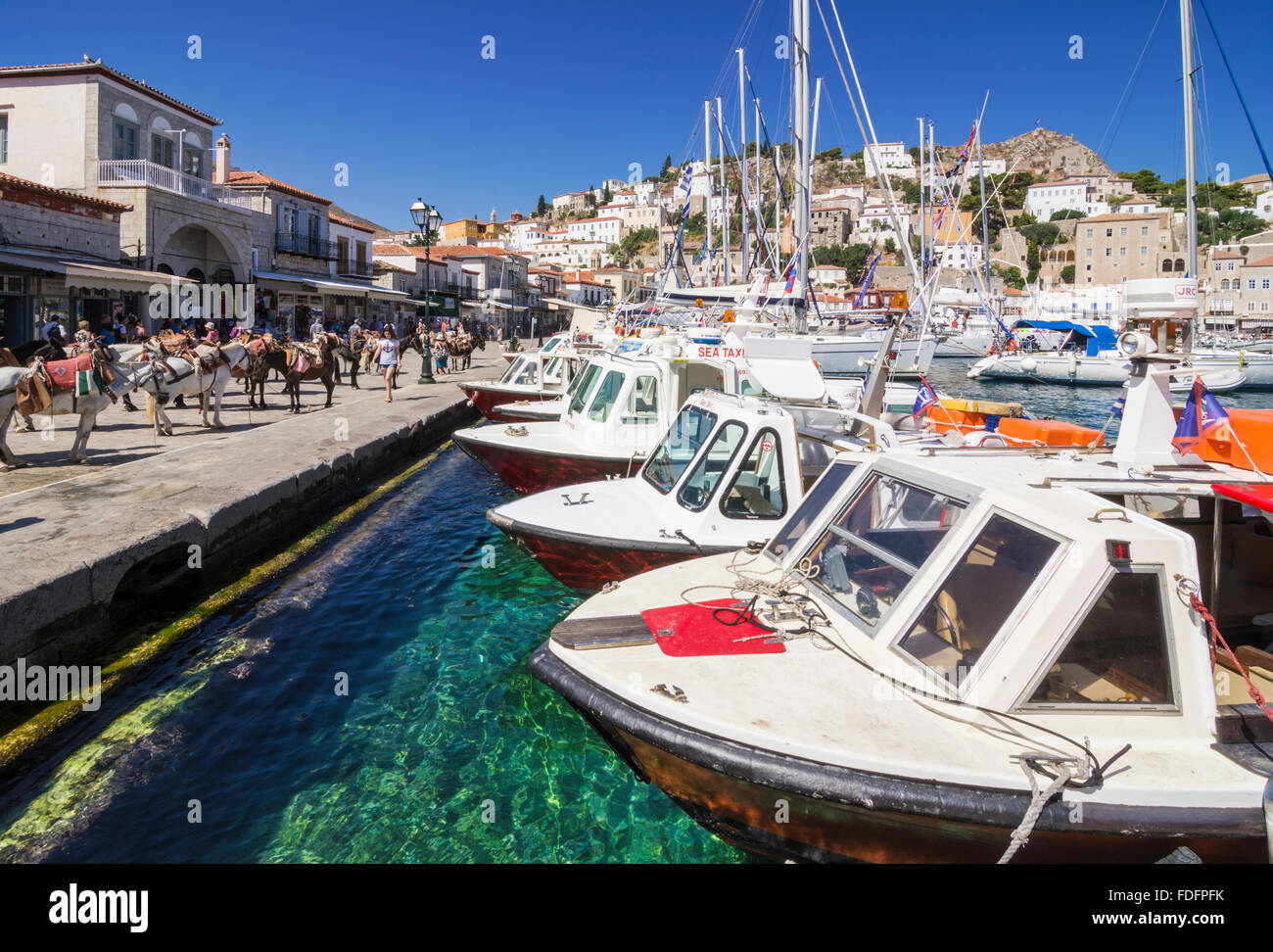 Boats moored along Hydra Town's waterfront, Hydra Island, Greece - Stock Image