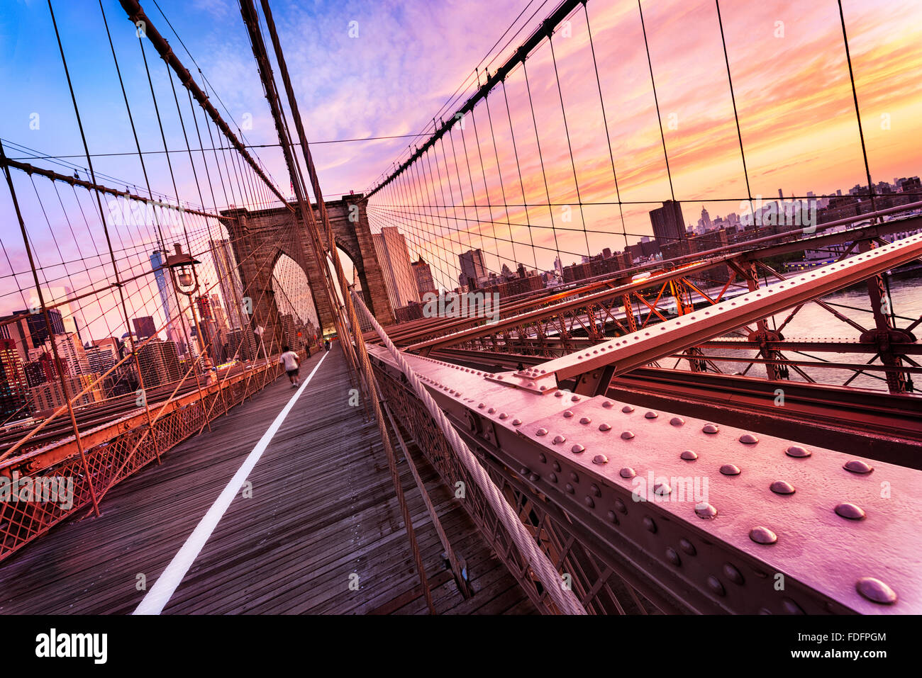 New York City, USA, early in the morning on the famous Brooklyn Bridge - Stock Image