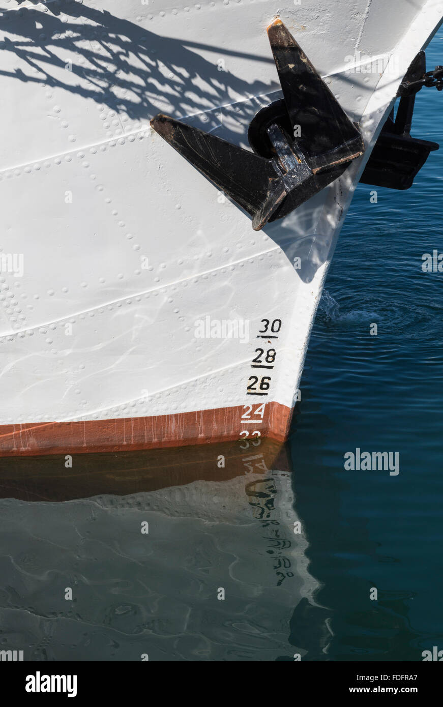 Draft or draught markings on bow of boat. - Stock Image