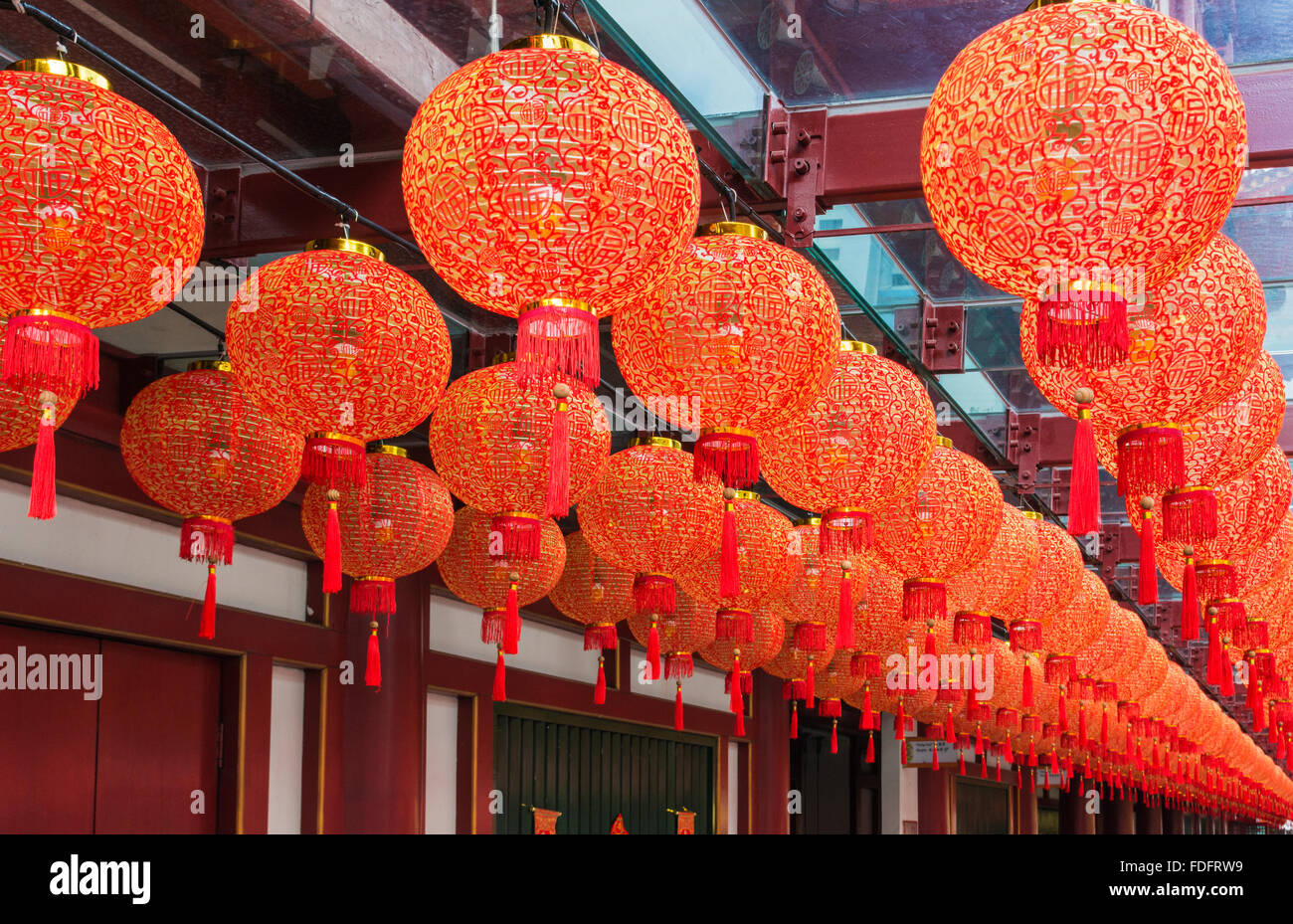 Traditional red lanterns hang from the Buddha Tooth Relic Temple and Museum during Chinese New Year in Chinatown, - Stock Image