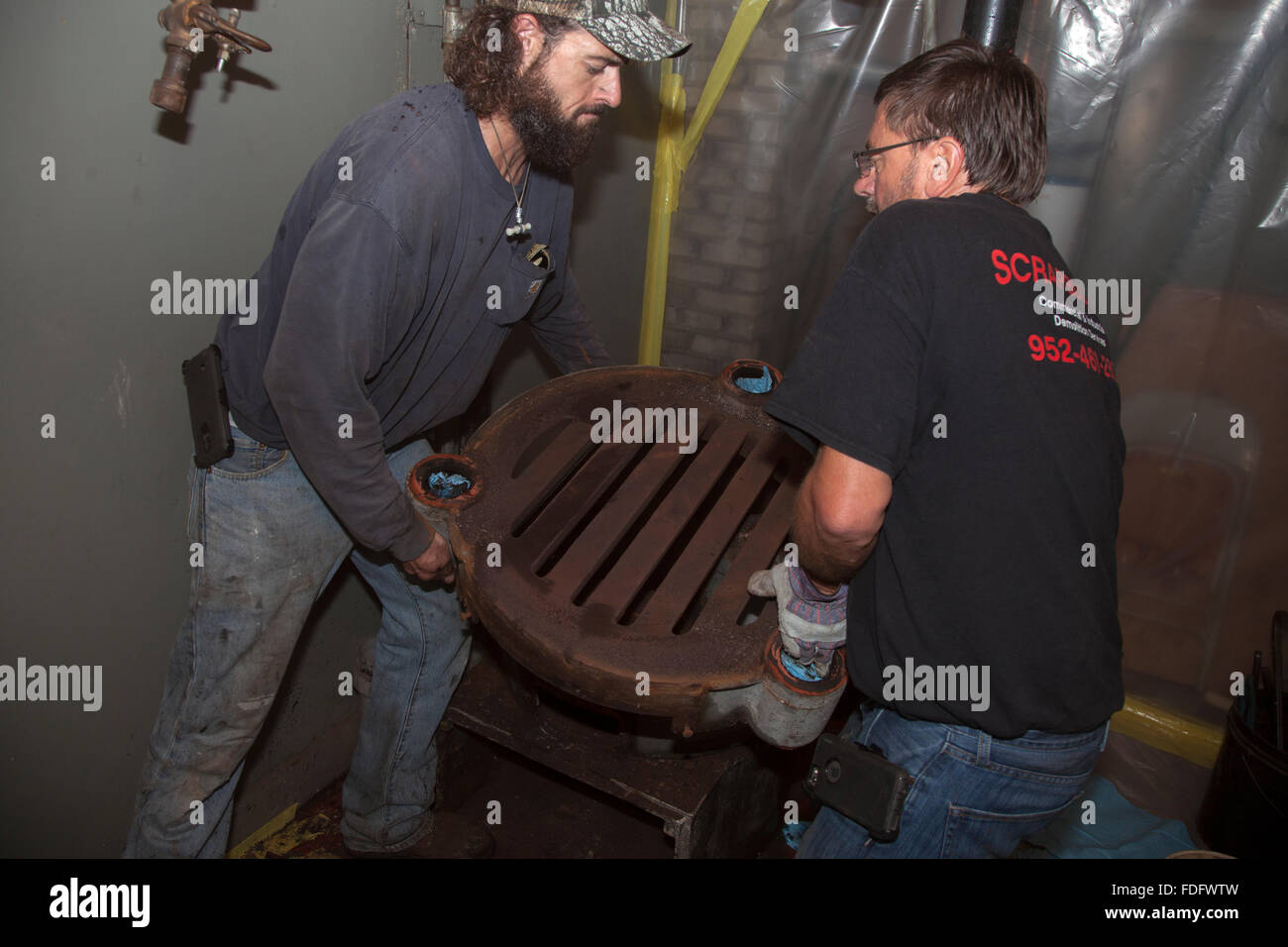 Water Boiler Furnaces Stock Photos Gravity Furnace Wiring Removing Parts Of Old From Basement For Replacement With A Modern Heat Pump