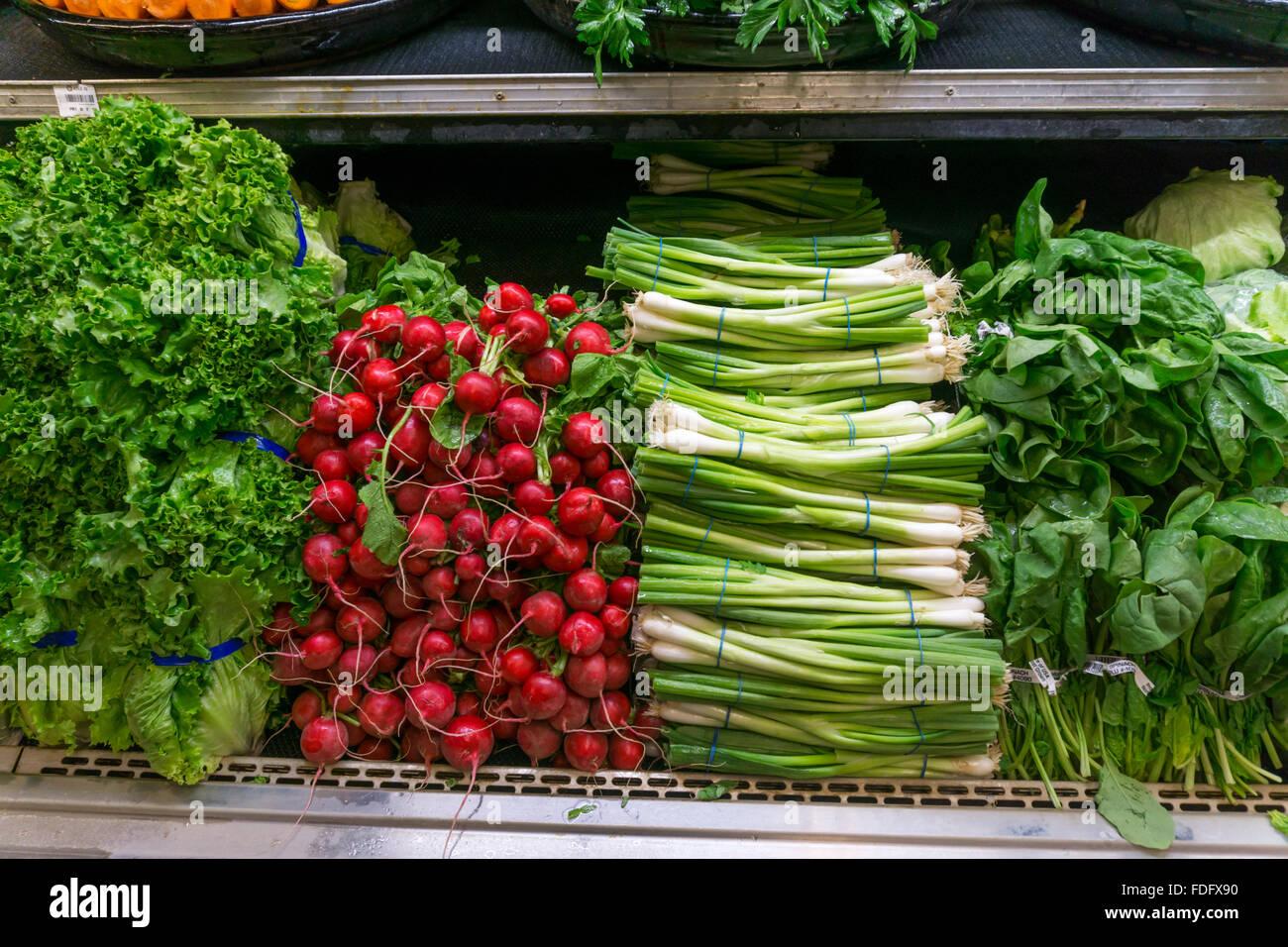 Fresh salad vegetables for sale in a supermarket - Stock Image