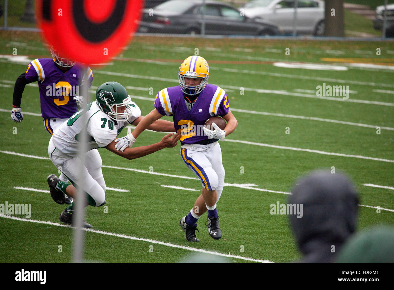 Mounds View football player tackling Cretin-Derham Hall High School runner with ball Jr. Varsity game. St Paul Minnesota - Stock Image