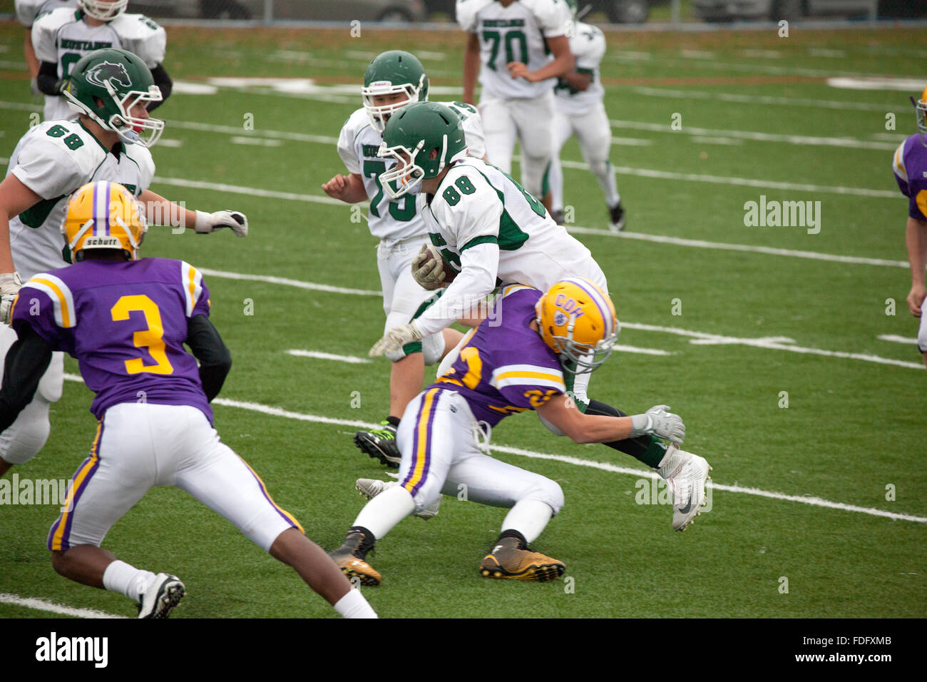 Mounds View High School football player being tackled by Cretin-Derham Hall in a Jr Varsity game. St Paul Minnesota - Stock Image