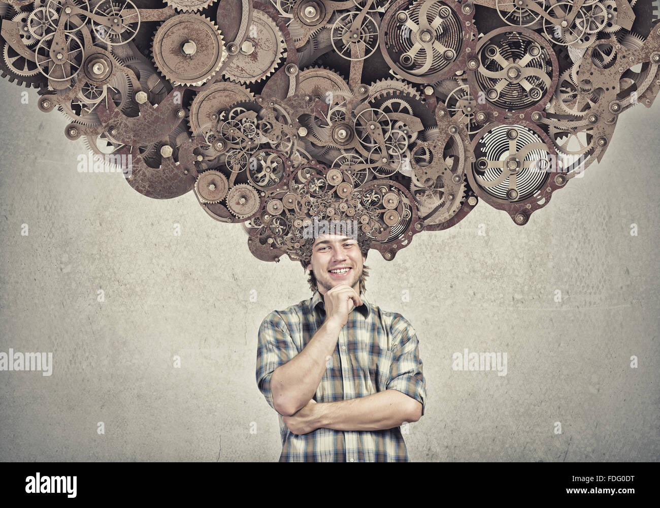Thoughtful guy with gear mechanisms above his head - Stock Image