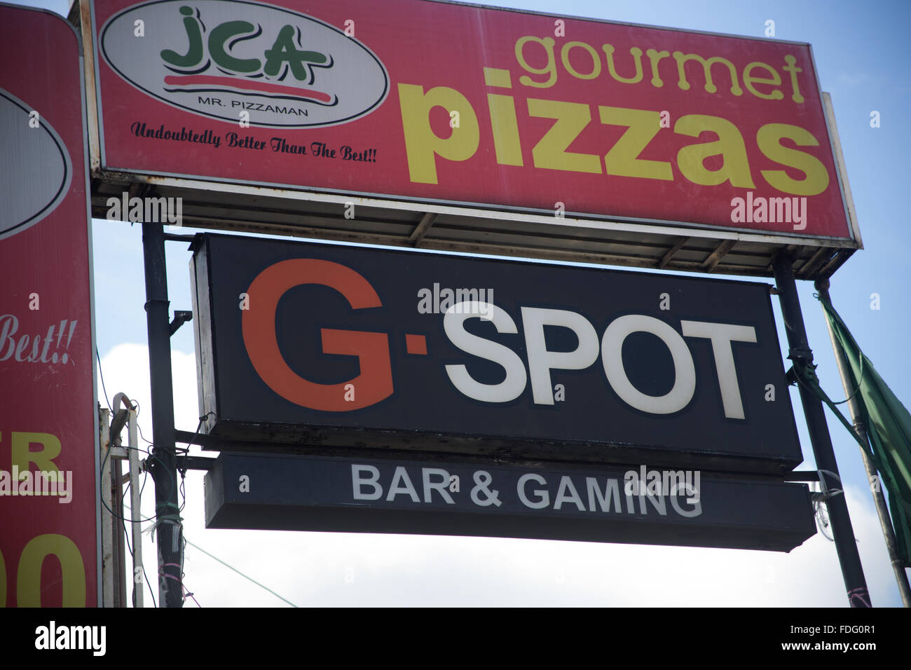 A humourous sign advertising a local bar in Cebu City,Philippines - Stock Image