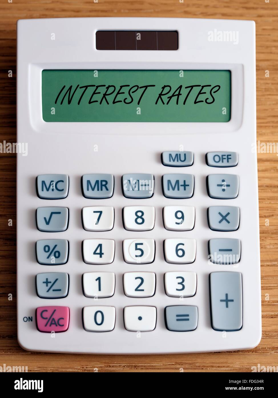 Interest rates on a calculator screen. - Stock Image