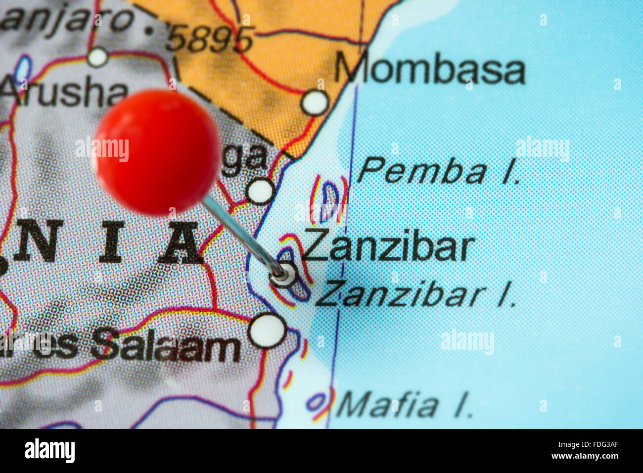 Close-up of a red pushpin in a map of Zanzibar, Tanzania. - Stock Image