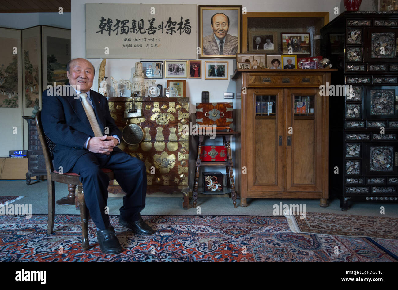 Korean-born paediatrician Sukil Lee sits in his living room that has been decorated with mementos in Mainz, Germany, - Stock Image