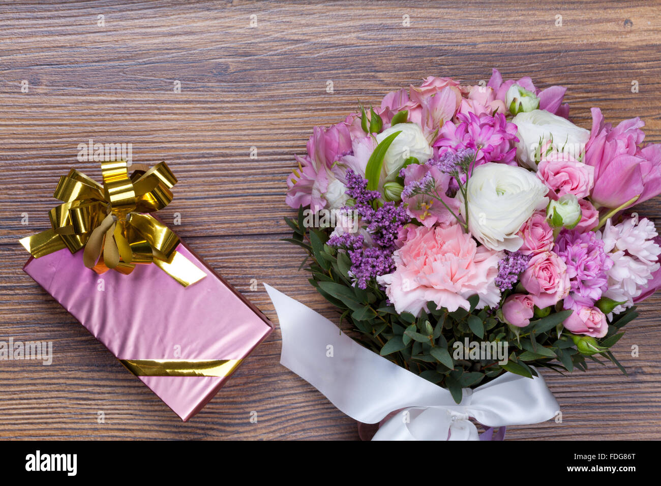 Valentine Gift Pack With Flowers On Florist Table Stock Photo