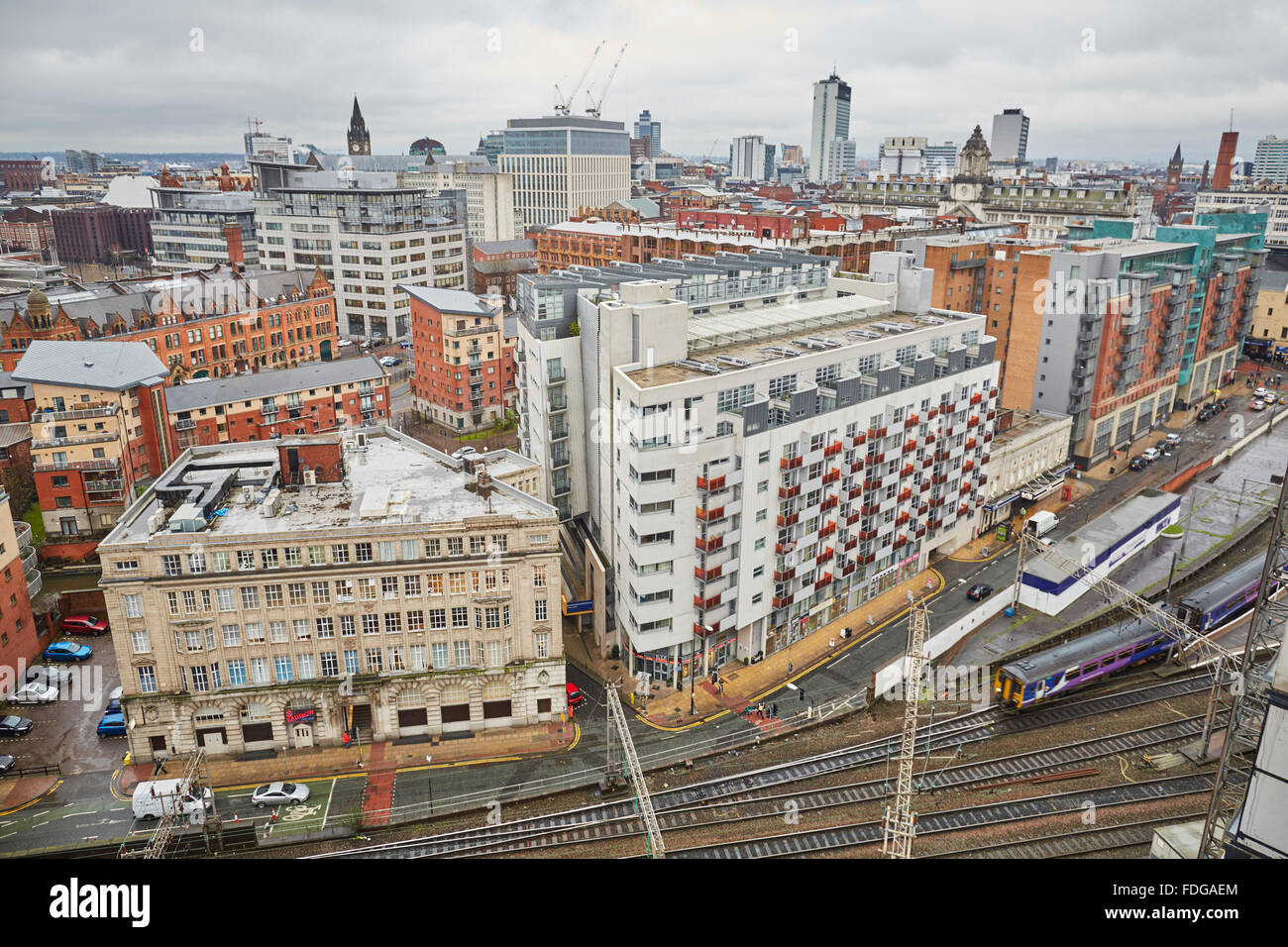 Northern Rail sprinter train leaves Manchester Oxford Road to run parallel with Whitworth Street   Travel Travellers - Stock Image