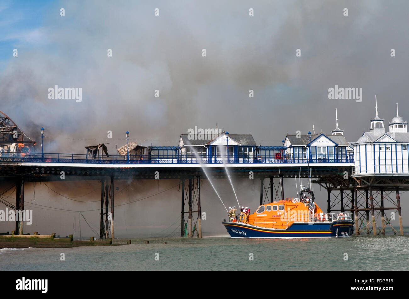 A lifeboat helps to tackle the fire which broke out on the Victorian Pier in Eastbourne, East Sussex - Stock Image