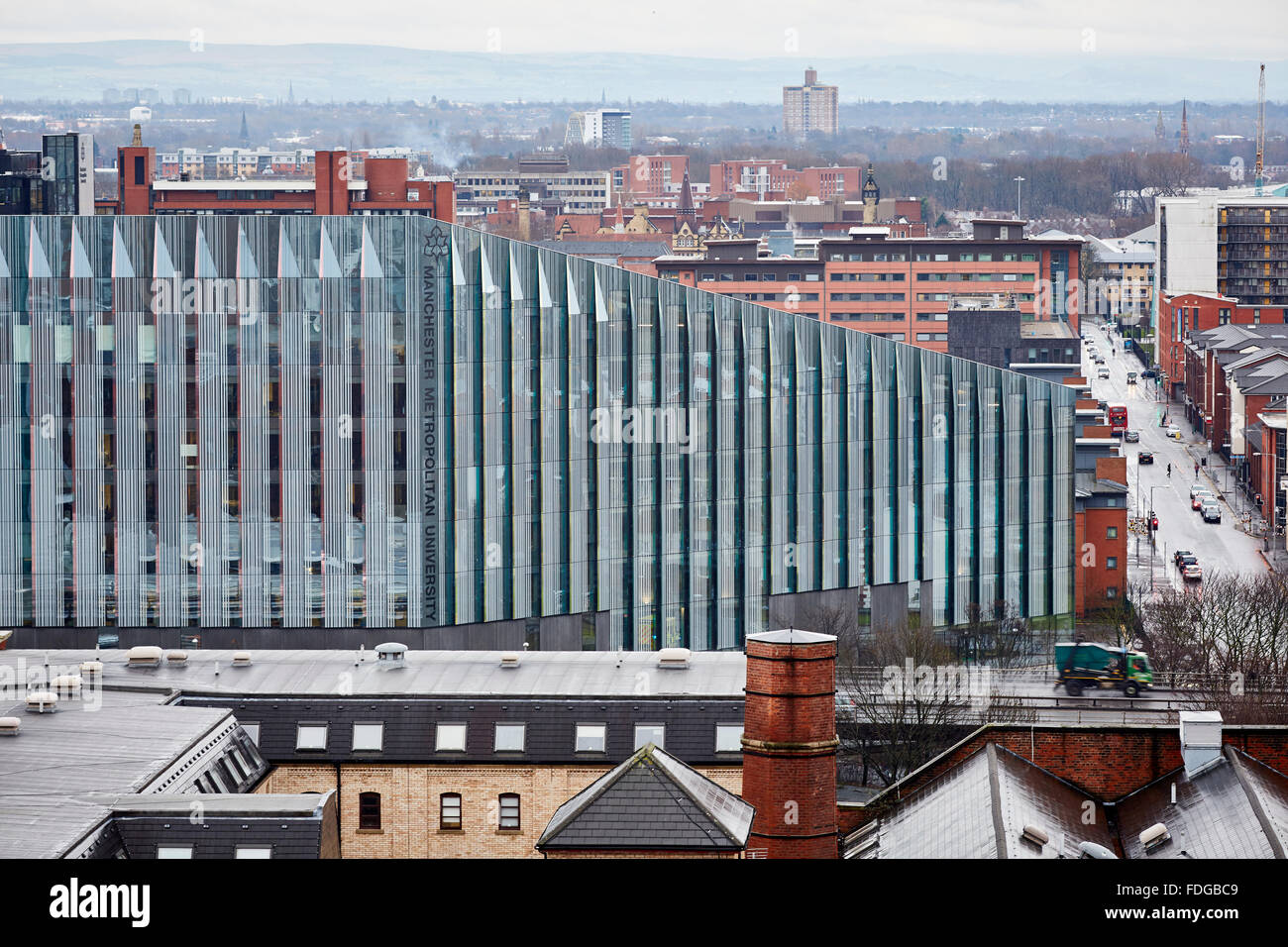 Manchester Metropolitan University building and the Mancunian Way    rain damp weather tracks high view point looking - Stock Image