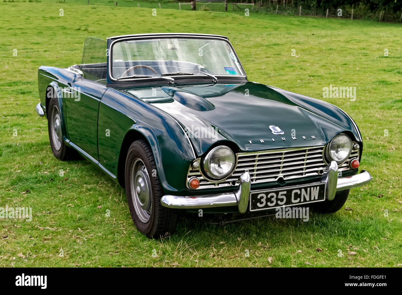 A British Manufactured Triumph Tr4 2 Door Roadster Sports Car At The