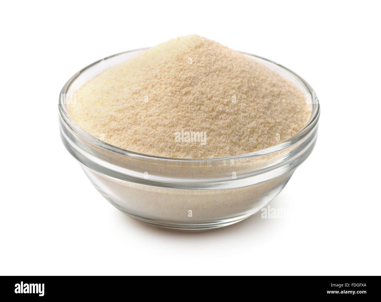 Bowl of semolina isolated on white - Stock Image