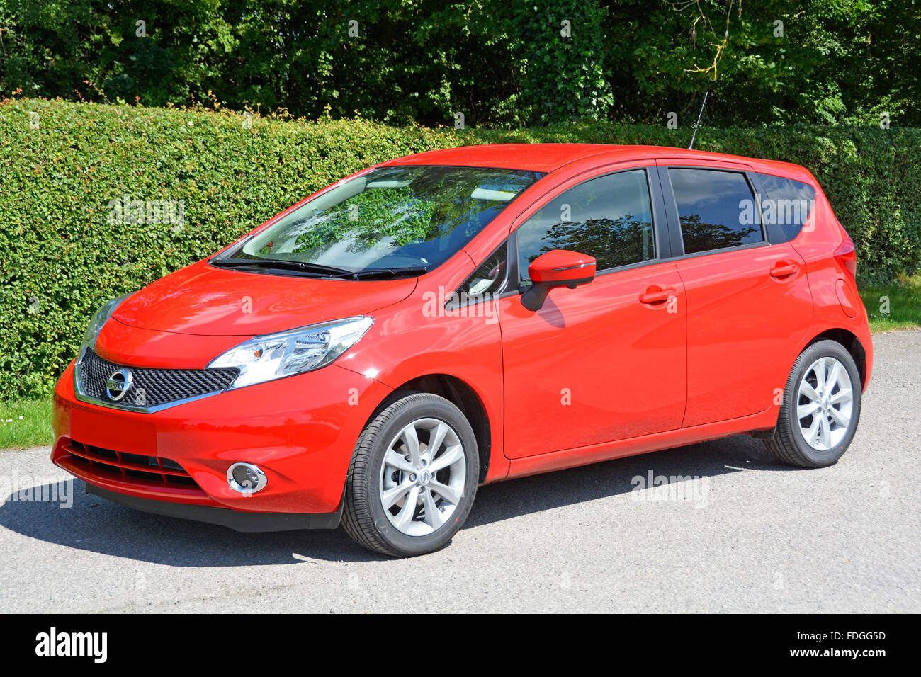 Nissan Note Tekna super mini hatchback car with a 1.2 litre petrol engine (obscured numberplate) - Stock Image