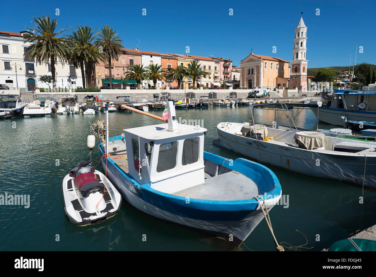 Fishing and motor boats in the picturesque harbor of Scario on the coast of the Mediterranean Sea in Cilento, Campania, - Stock Image