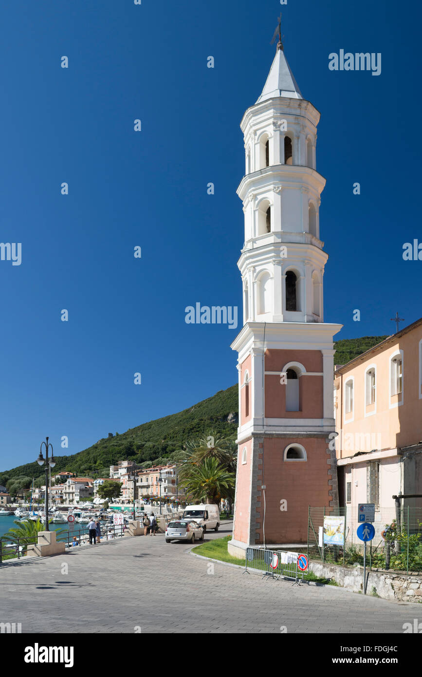 White church steeple against a blue sky at the harbor of Scario at the coast of the Mediterranean Sea in Cilento,Campania,Italy - Stock Image
