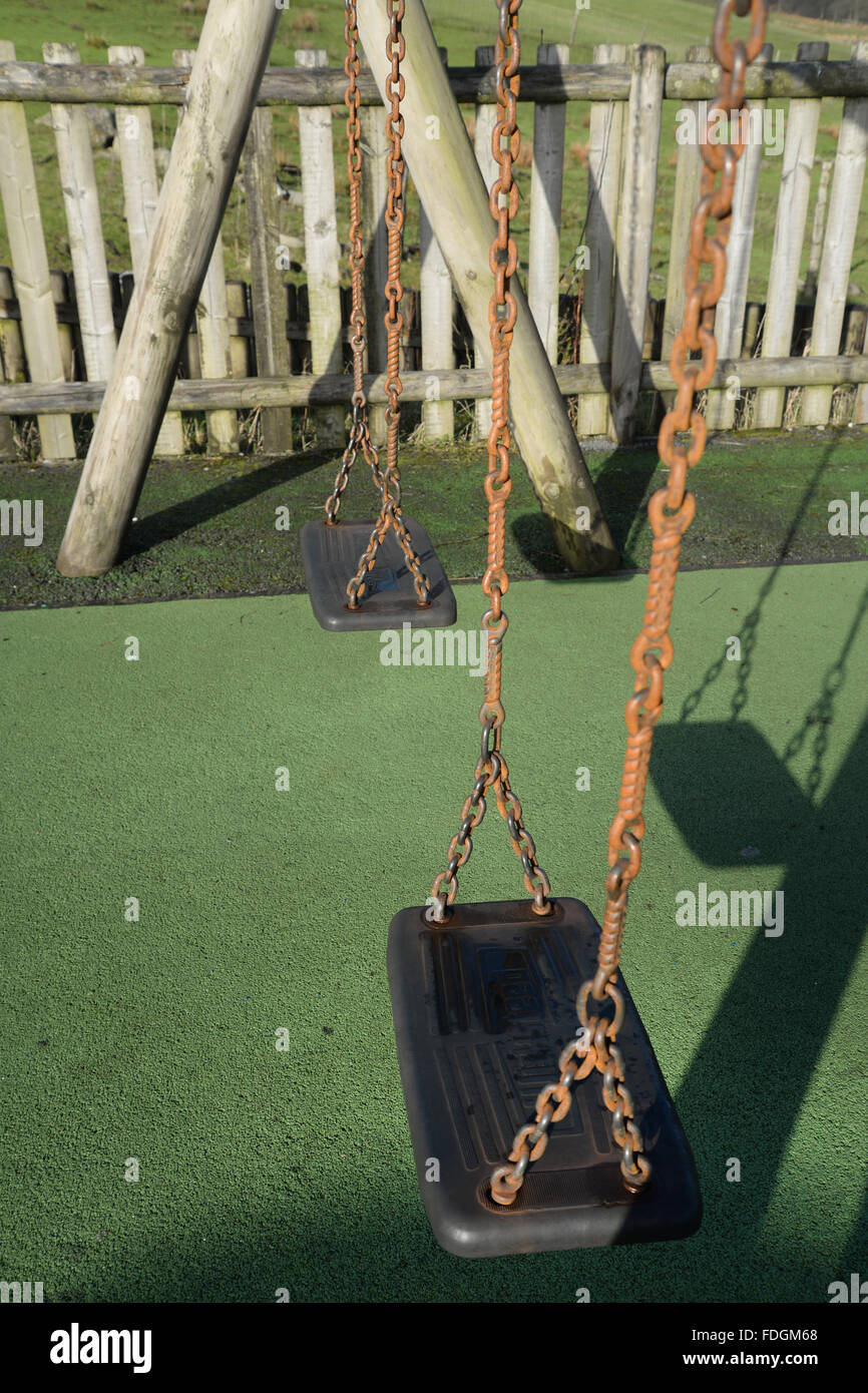 Generil file stock picture of childrens swings at the playground at the quarry village of Trefil, South Wales, UK. - Stock Image