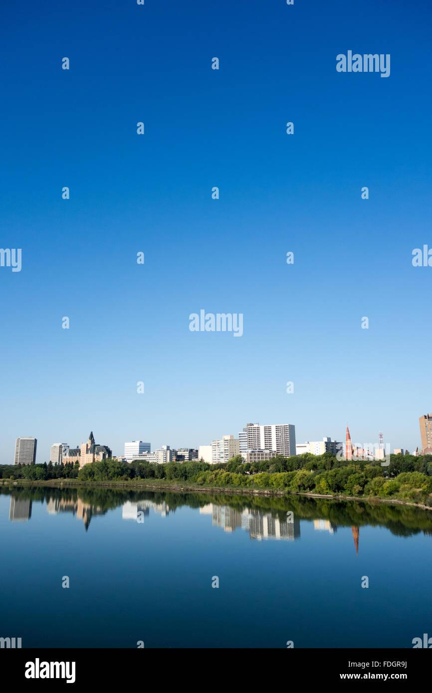 Saskatoon skyline and the South Saskatchewan River, Canada - Stock Image