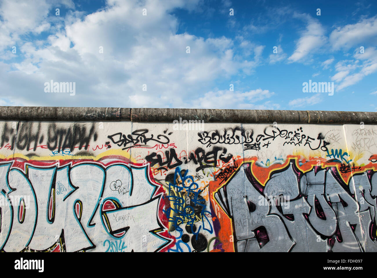 Artwork on the Berlin Wall at the East Side Gallery, Germany - Stock Image