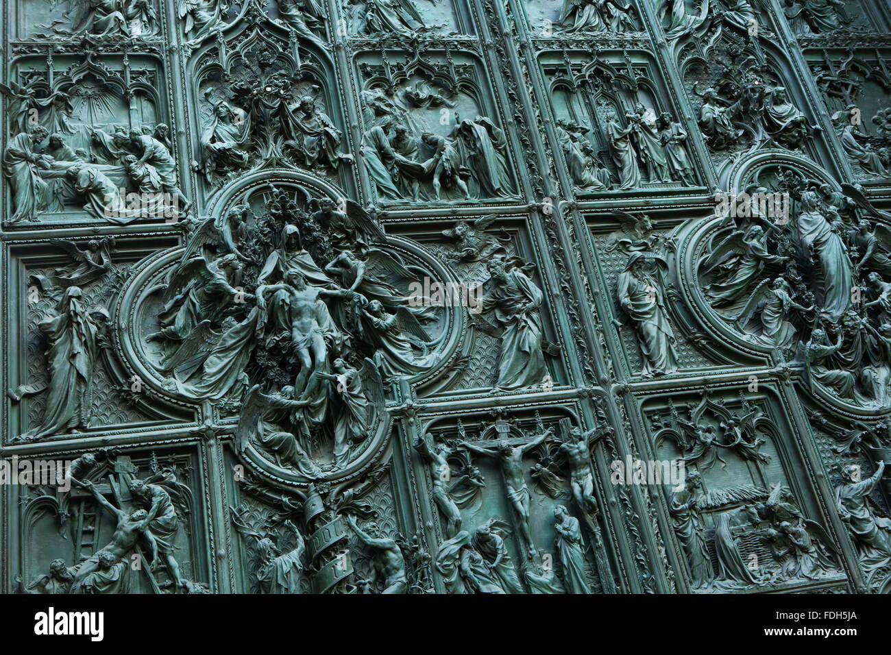 Main bronze door of the Milan Cathedral (Duomo di Milano) designed by Italian sculptor Ludovico Pogliaghi in Milan, - Stock Image