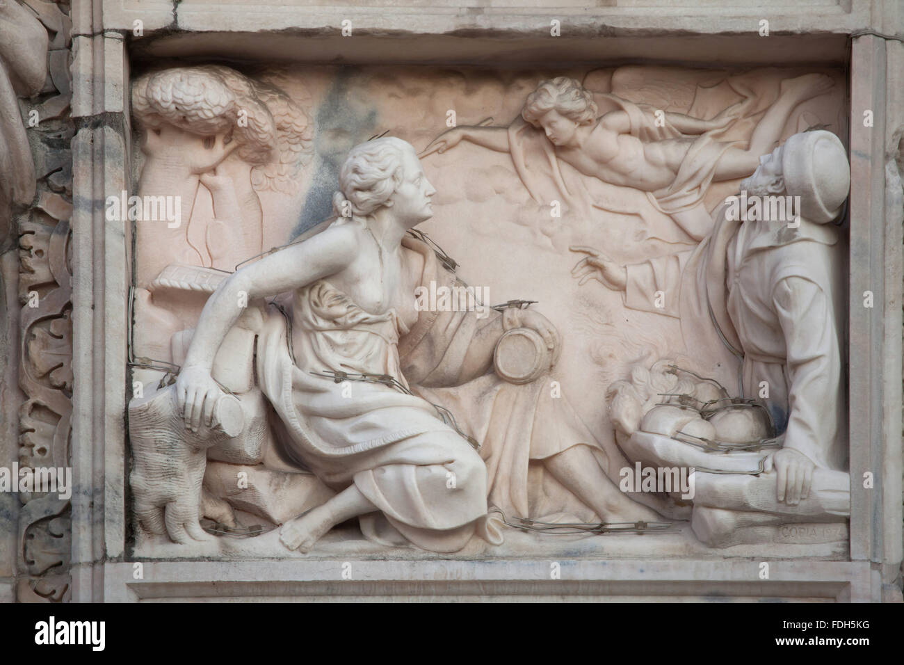 Biblical scene depicted in the marble relief on the main facade of the Milan Cathedral (Duomo di Milano) in Milan, - Stock Image