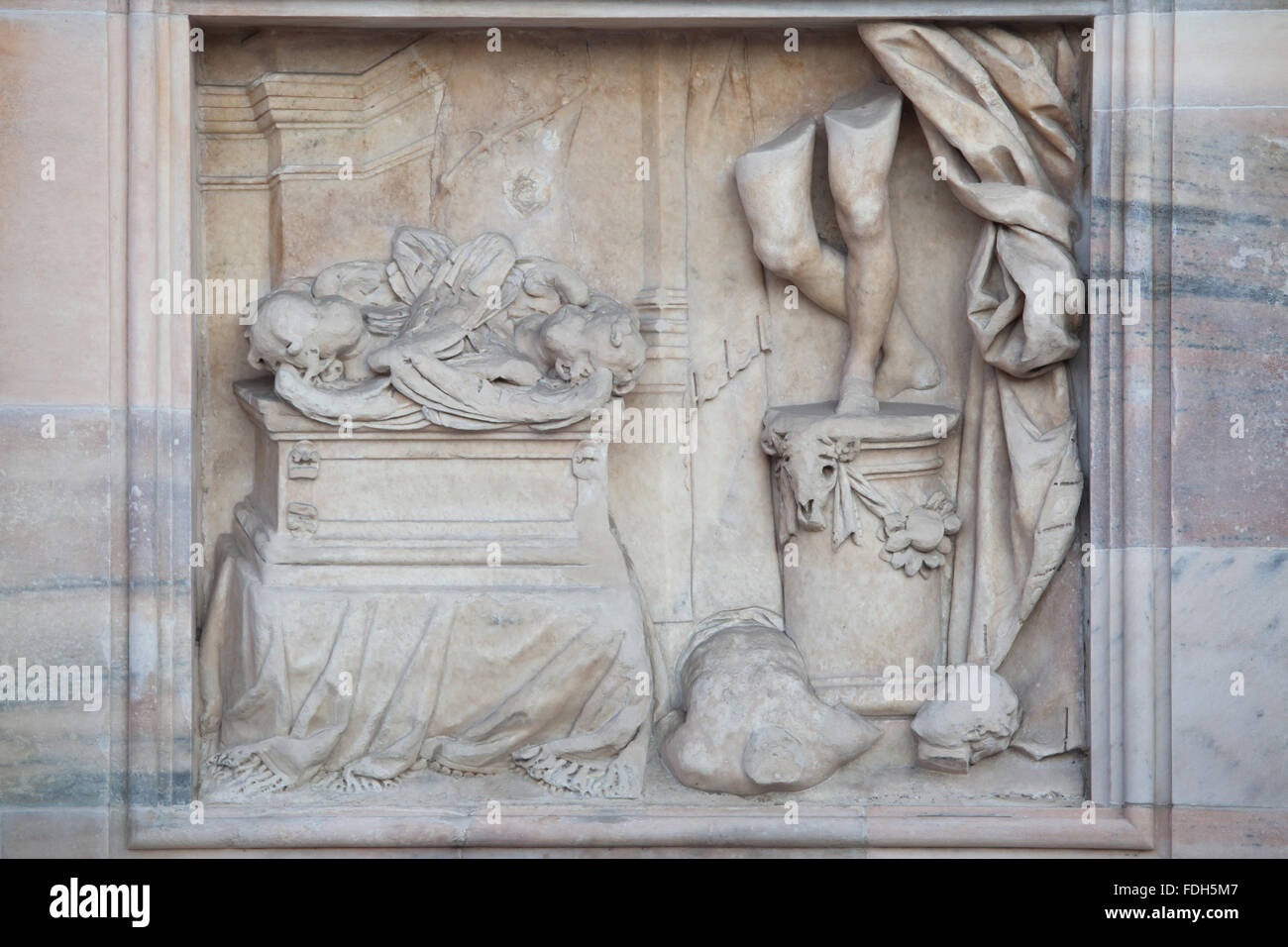 Allegorical scene depicted in the marble relief on the main facade of the Milan Cathedral (Duomo di Milano) in Milan, - Stock Image