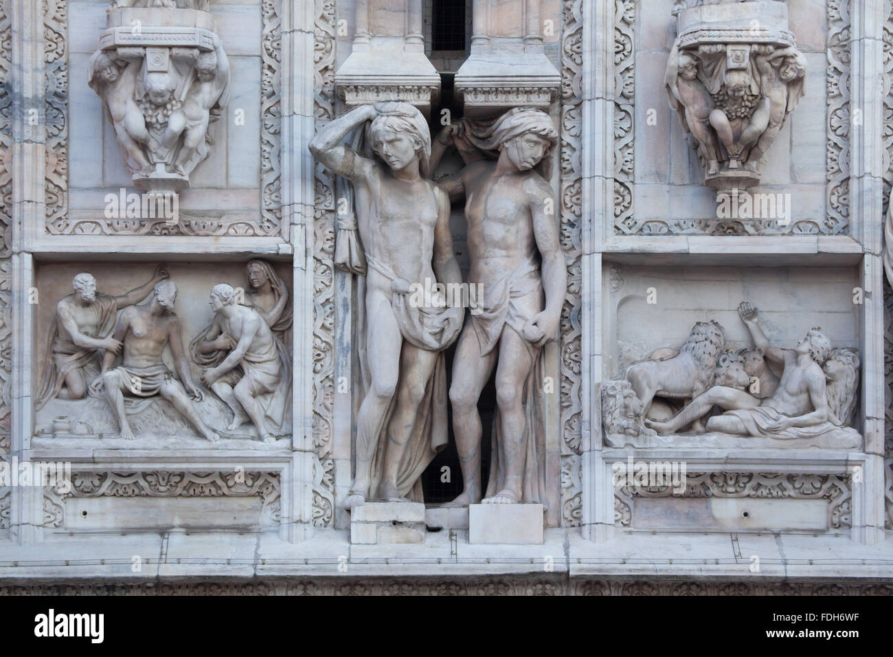 Atlantes supporting the main facade of the Milan Cathedral (Duomo di Milano) in Milan, Lombardy, Italy. Marble relieves - Stock Image