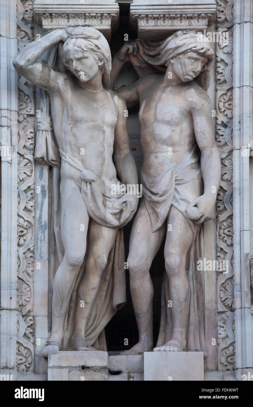 Atlantes supporting the main facade of the Milan Cathedral (Duomo di Milano) in Milan, Lombardy, Italy. - Stock Image